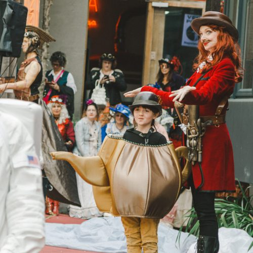 Street theatre, steam punk mum with a small child dressed as a teapot